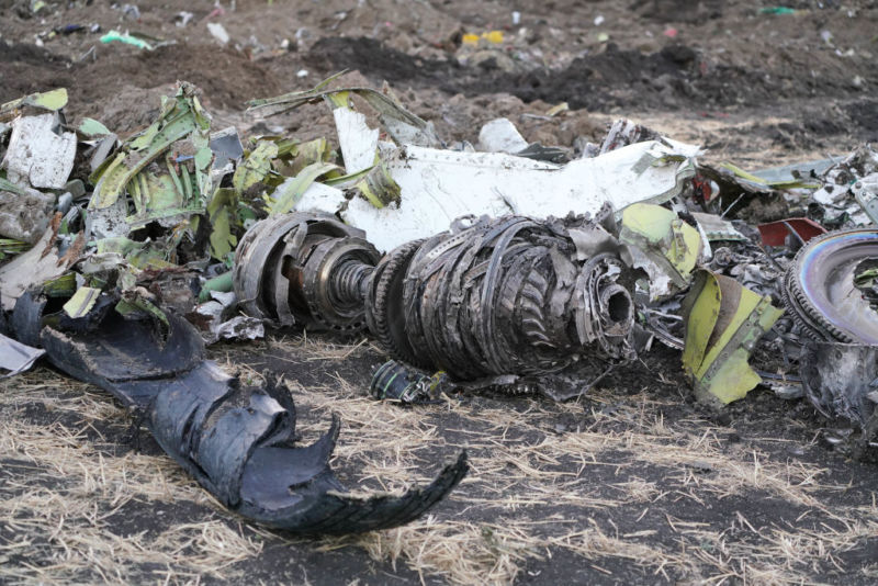 Parts of an engine and landing gear lie in a pile after being gathered by workers during the continuing recovery efforts at the crash site of Ethiopian Airlines flight ET302 on March 11, 2019 in Bishoftu, Ethiopia. (Photo by Jemal Countess/Getty Images)