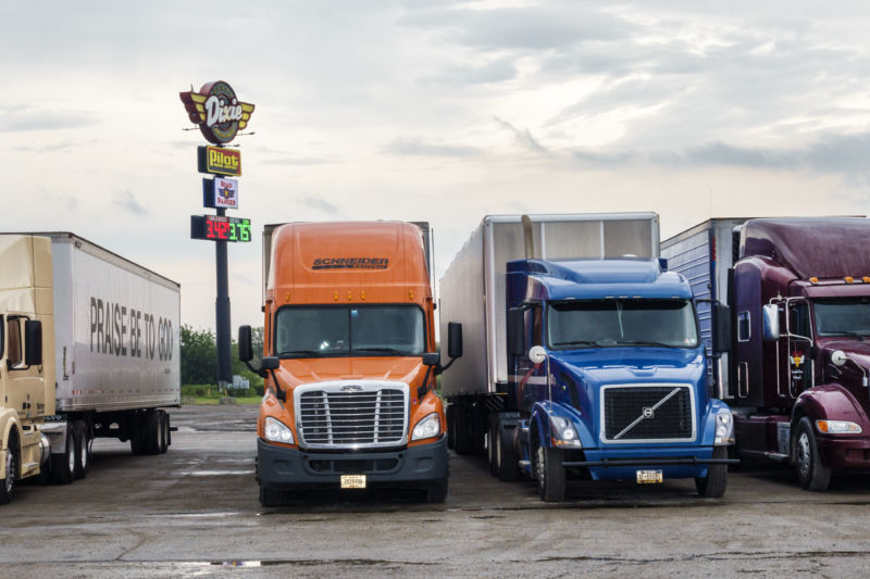 Trucks lined up at a truck stop.