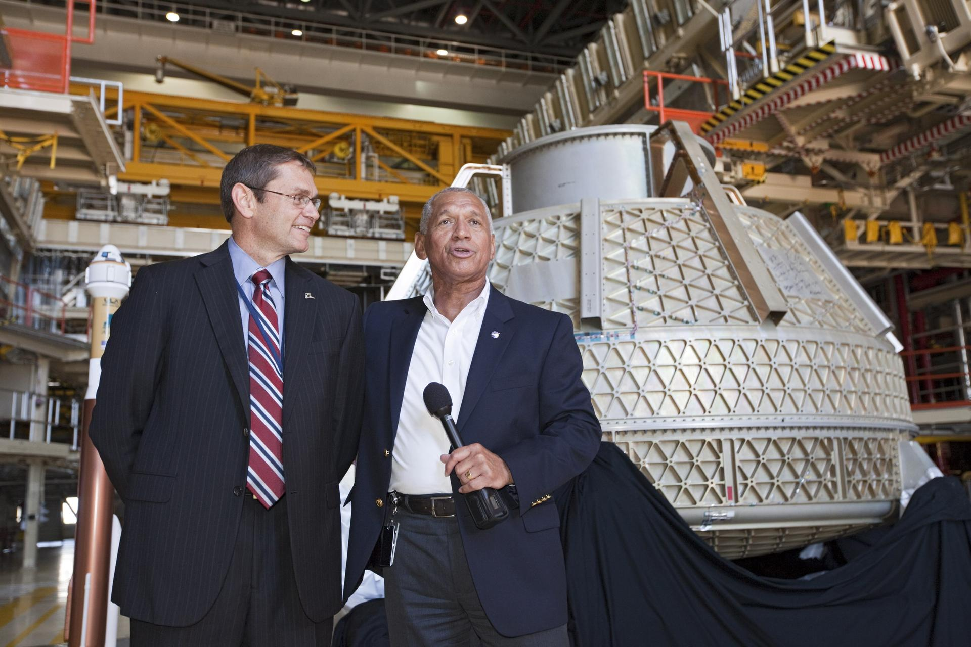 NASA Administrator Charlie Bolden, right, and Boeing space chief John Elbon in front of a Starliner in 2012.