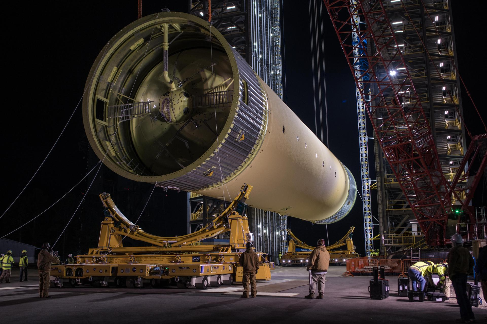 The SLS rocket's 45-meter long liquid hydrogen tank structural test article is loaded into Test Stand 4693 at NASA's Marshall Space Flight Center in January.