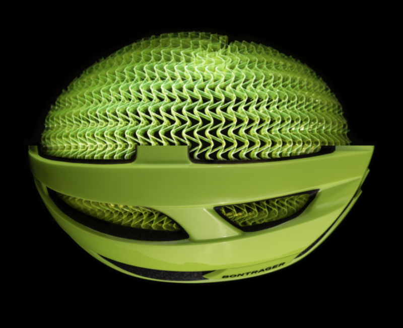 Image of a bike helmet cutaway to reveal a green mesh underneath.