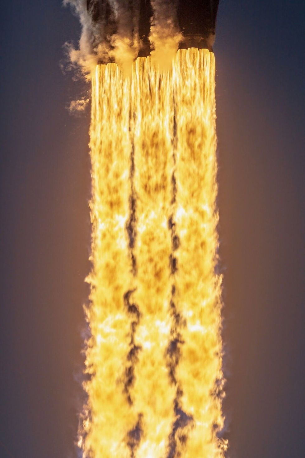 The Falcon Heavy fires its 27 engines on the way to space.
