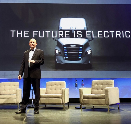 Roger Nielsen, president and CEO of Daimler Trucks North America standing on a stage.