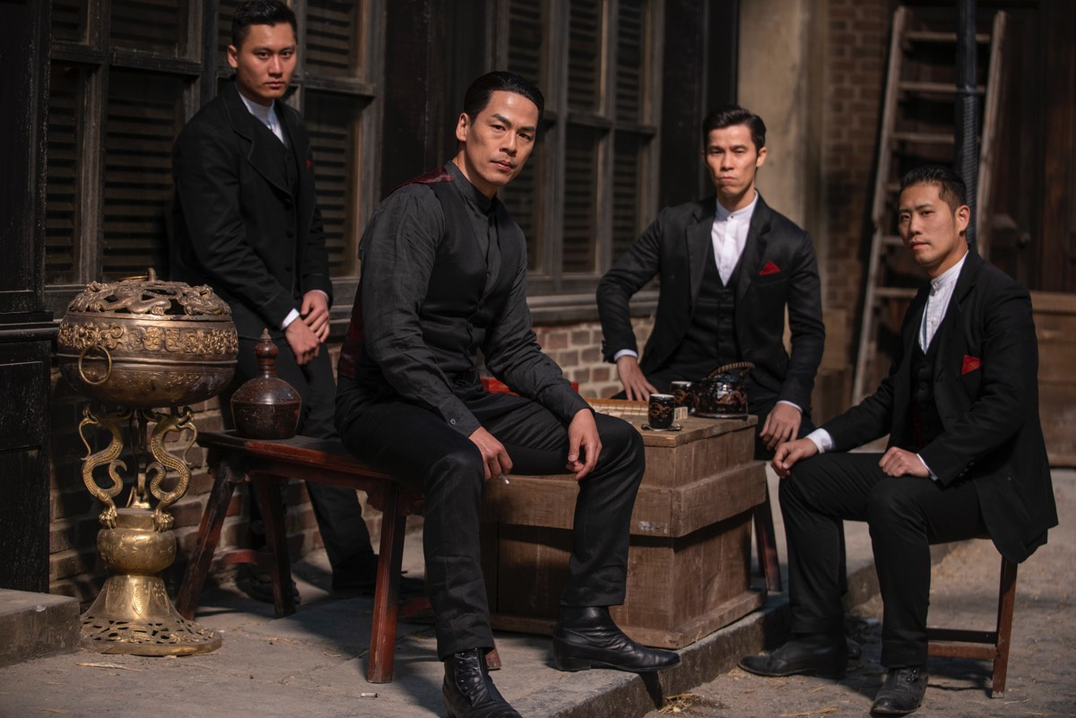 Ah Sahm's tong brotherhood includes Bolo (Rich Ting, center left) and Young Jun (Jason Tobin, center right).