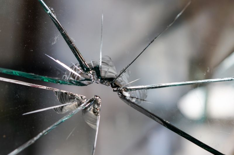 Image of a broken glass window.