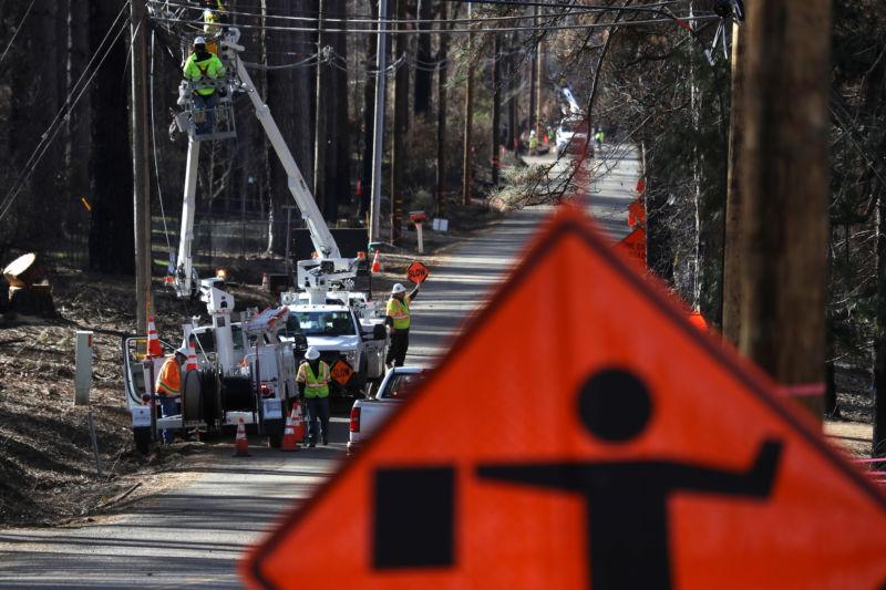 workers rebuilding power lines in California.