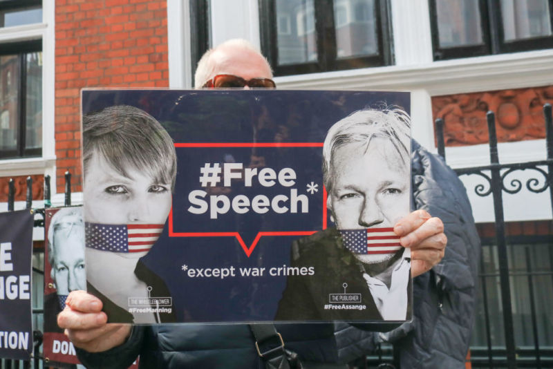Supporters of Julian Assange protest outside the Ecuadorian embassy as the WikiLeaks founder awaits a High Court hearing to determine whether he will be extradited to Sweden on sexual charges. Now, new US charges have been added to a previous indictment: 17 counts of espionage.