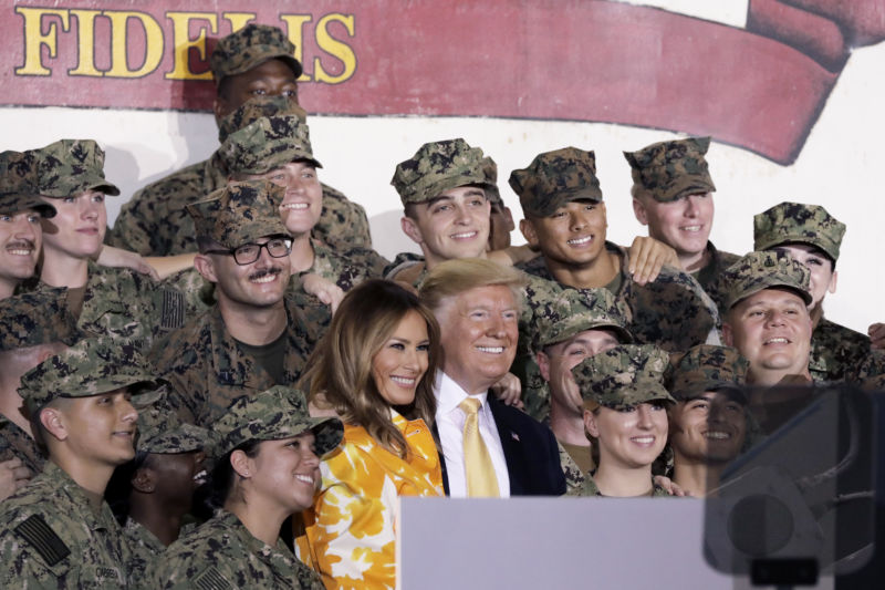 "US President Donald Trump and First Lady Melania Trump pose for a photograph with US military personnel aboard the USS <em>Wasp</em> aircraft carrier at the US naval base in Yokosuka, Kanagawa Prefecture, Japan, on Tuesday, May 28,2019 Trump told troops stationed in Japan he plans to order traditional steam-powered catapults aboard American warships instead of newer electromagnetic systems that he said may not work as well during wartime. ""><br /> < img src ="