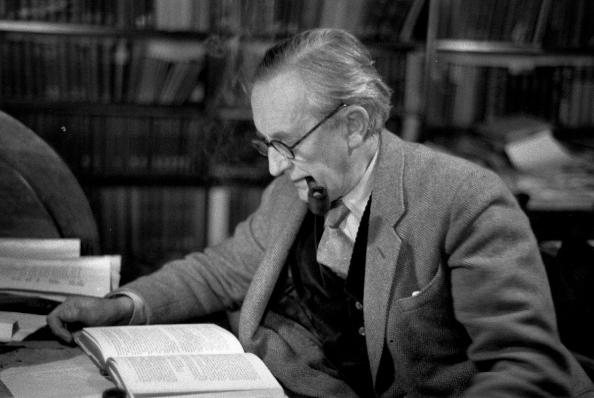 J.R.R. Tolkien reading in his study at Merton College, Oxford, in December 1955.
