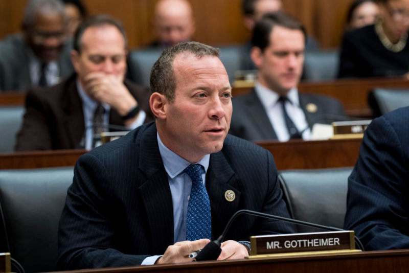 Rep. Josh Gottheimer seated in front of a microphone at a Congressional committee meeting.