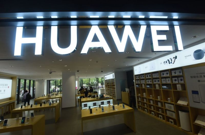 Customers purchase mobile phones at a Huawei store in China.