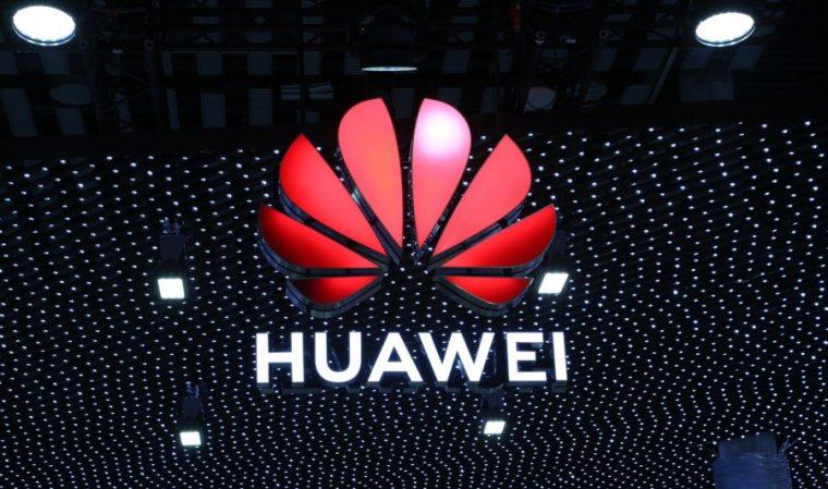 Giant Huawei logo onstage.