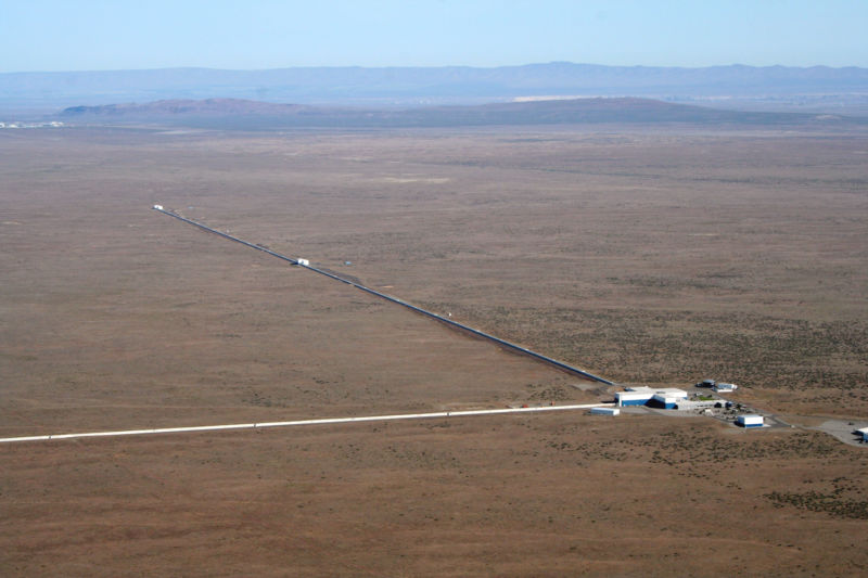 Image of two long arms of the LIGO detector in the desert of eastern Washington.