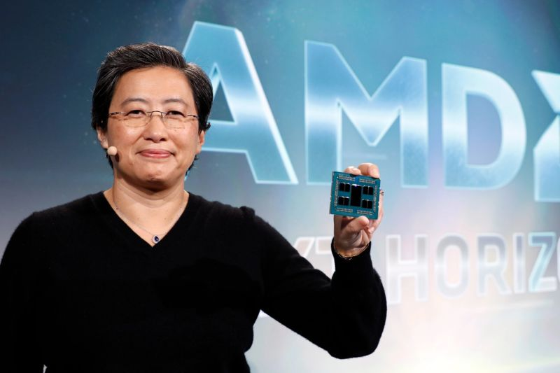 AMD CEO Lisa Su, holding a Rome processor. The large chip in the middle is the 14nm I/O chip; around it are pairs of 7nm chiplets containing the CPU cores.