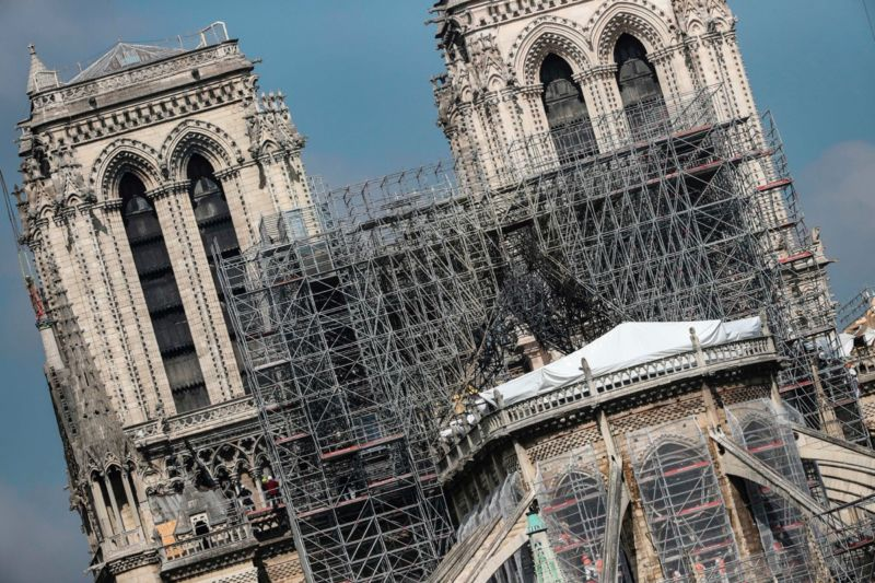 Protective tarps displayed on the roof of Notre-Dame de Paris cathedral, two weeks after a fire devastated it.