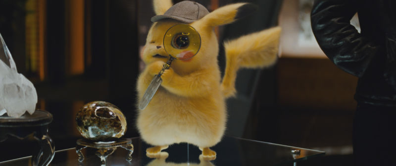 How do you know it's <em>Detective</em> Pikachu, not just standard Pikachu? Clues: the hat, the magnifying glass, the lush fur.