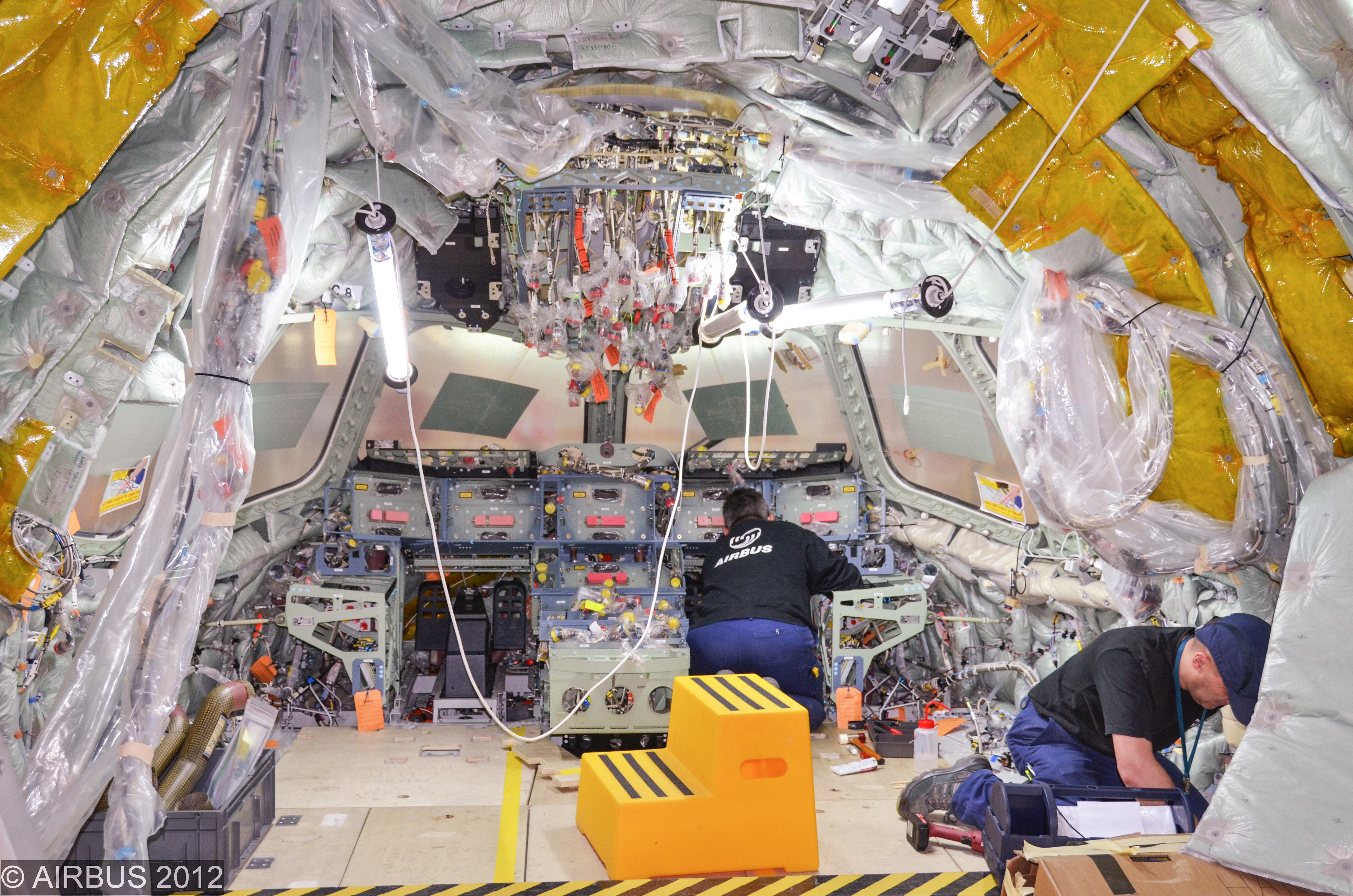 """An airplane being assembled at an Airbus facility. The company is developing """"smart tools"""" that use local and network intelligence as part of its own Industry 4.0 """"factory of the future"""" initiative."""