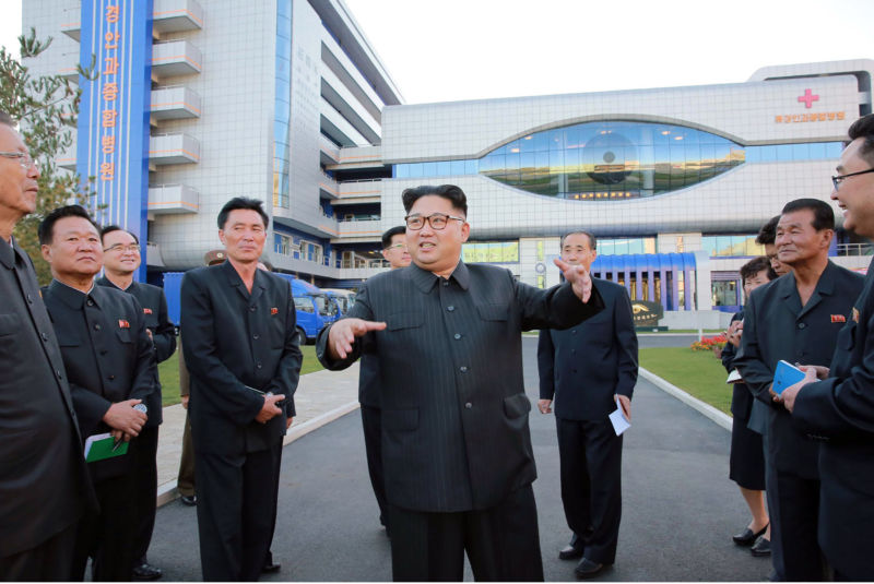 This undated picture released by North Korea's official Korean Central News Agency (KCNA) on October 18, 2016, shows North Korean leader Kim Jong-Un (C) inspecting the newly built Ryugyong General Ophthalmic Hospital in Pyongyang.