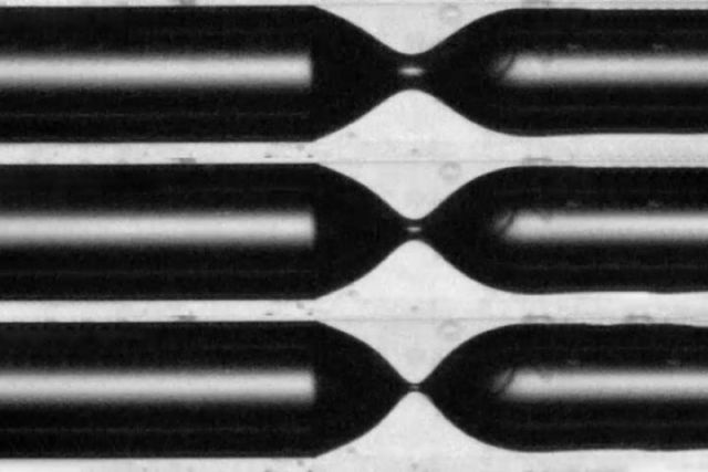 "This series of images shows the process of ""pinch-off"" in which the air bubble (black) starts to separate off as it penetrates into a liquid environment (white) inside a narrow tube."