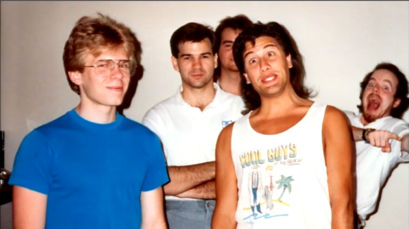 "John Carmack (left) and John Romero (second from right) pose with their id Software colleagues in the early '90s. We really hope USA Network's adaptation of their origin story gets this ""fashion"" just right."