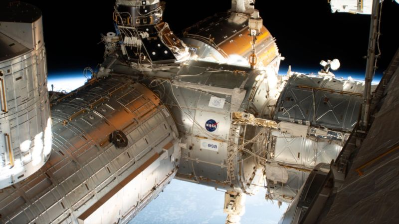 The forward end of the International Space Station is pictured showing portions of five modules. From right to left is a portion of the U.S. Destiny laboratory module linking forward to the Harmony module. Attached to the port side of Harmony (left foreground) is the Kibo laboratory module from the Japan Aerospace Exploration Agency (JAXA) with its logistics module berthed on top. On Harmony's starboard side (center background) is the Columbus laboratory module from ESA (European Space Agency).