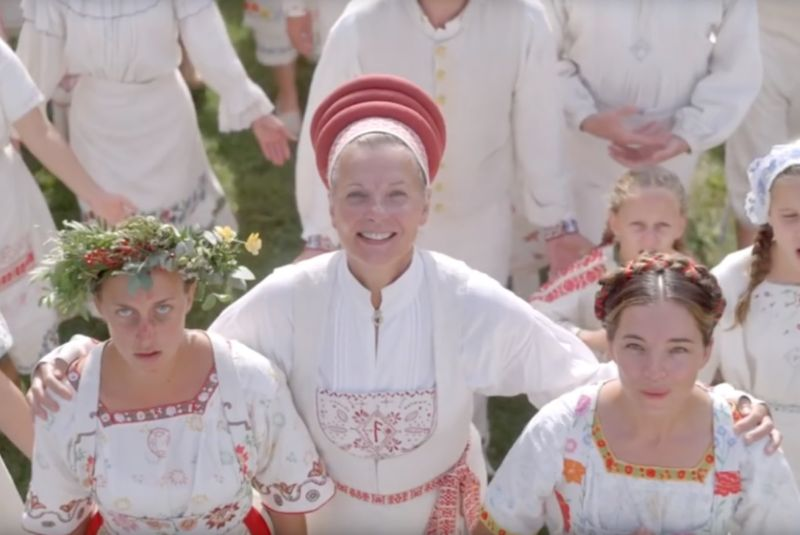 "Traveling to Sweden for a rare summer solstice pagan festival that only takes place every 90 years turns out not to be such a good idea in <em>Midsommar</em>.""><figcaption class="