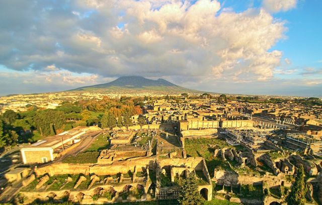 An aerial view of Pompeii, with Mt. Vesuvius still presiding over the scene.