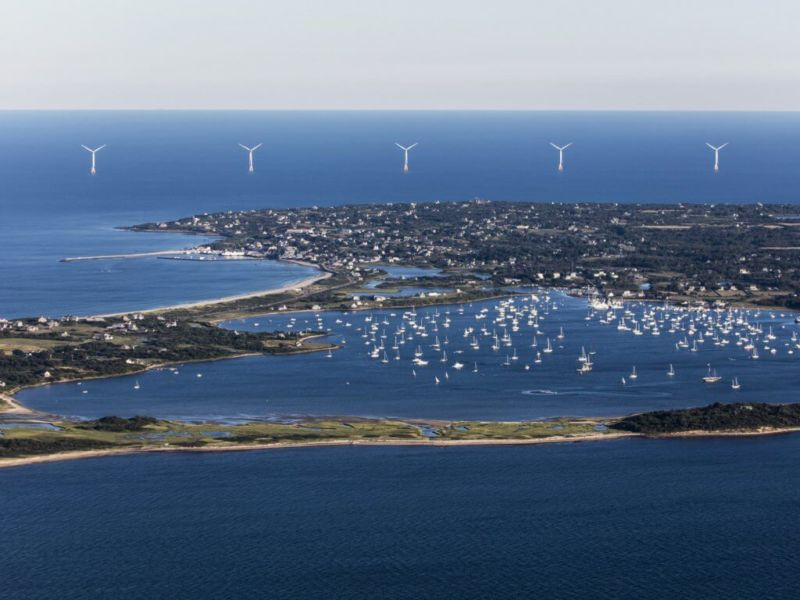 Image of wind turbines behind a large bay.