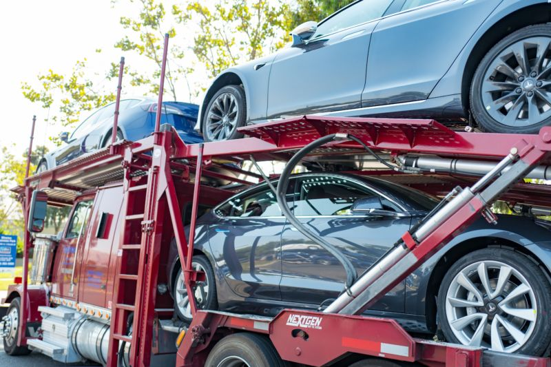 Tesla cars on a delivery truck in 2018.