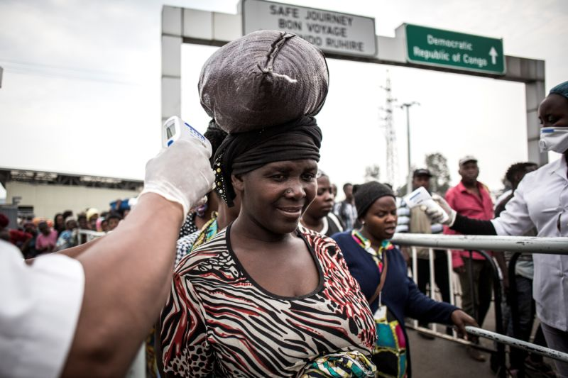 A woman has her temperature measured at an Ebola screening station when she arrives in Rwanda on 16 July 2019 in Goma, DRC.