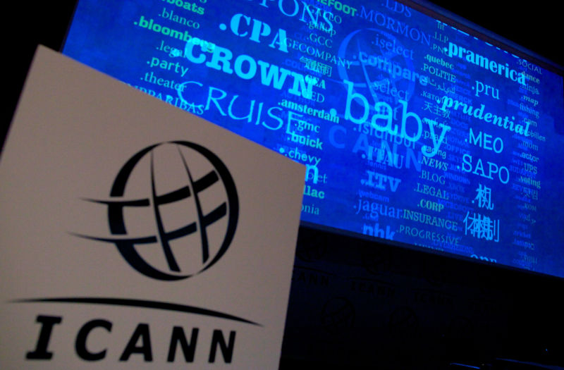 Video presentation behind a podium with an ICANN logo.