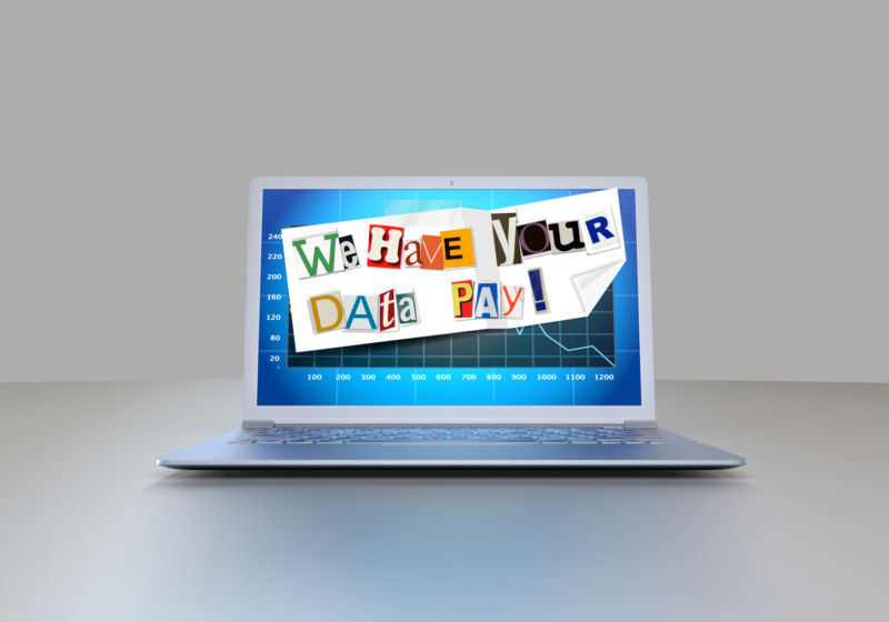 A ransom note is plastered across a laptop monitor.