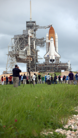 Reporters queued up to get a picture of the launch site.