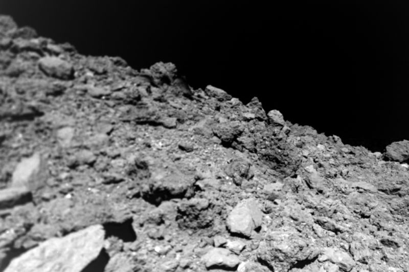 Ryugu's rubble-pile surface, taken by MASCOT shortly before it hit and started bouncing.