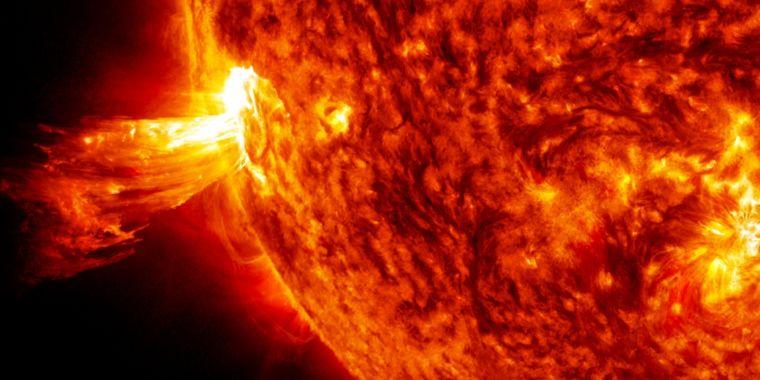 Identical Photons Generated 150 Million Kilometers Apart