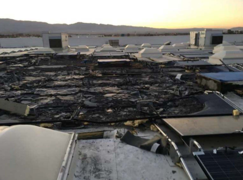 Fire damage on the roof of a Walmart store in Indio California