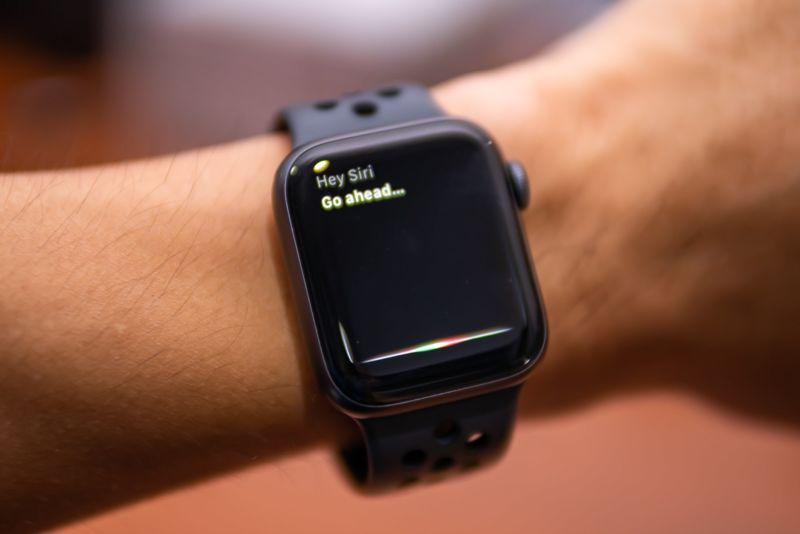 An Apple Watch on a person's wrist, with the Siri voice assistant activated.