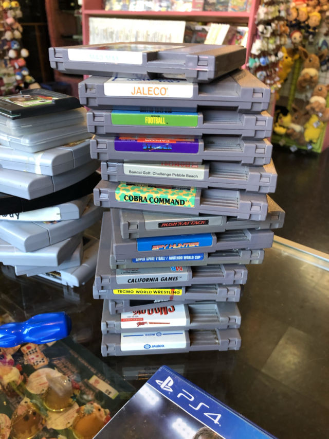 The most recently discovered Nintendo World Championship cartridge was buried in a brown paper sack, beneath this pile of unremarkable, unboxed NES fare.