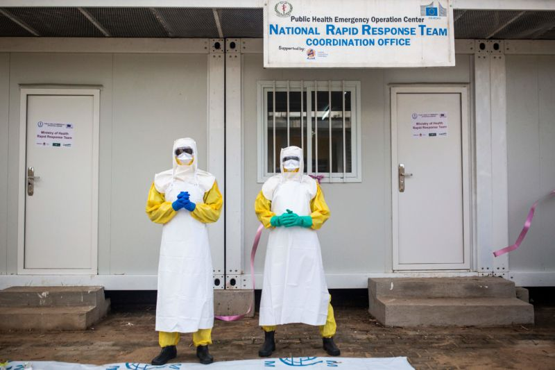 South Sudan Health Ministry staff posing in protective suits during an Ebola training session conducted by the World Health Organization (WHO).
