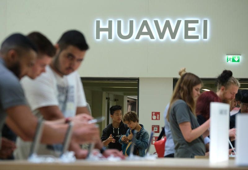 Visitors check out new Huawei smartphones at the 2019 IFA home electronics and appliances trade fair Berlin.