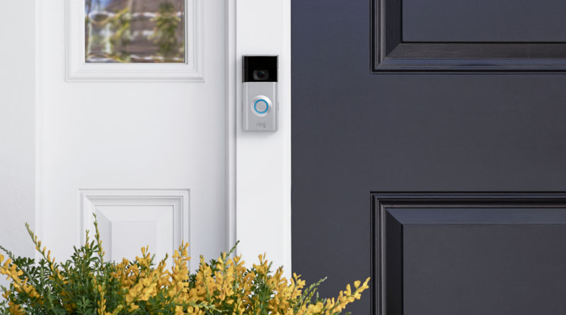 A Ring video doorbell mounted on a home.