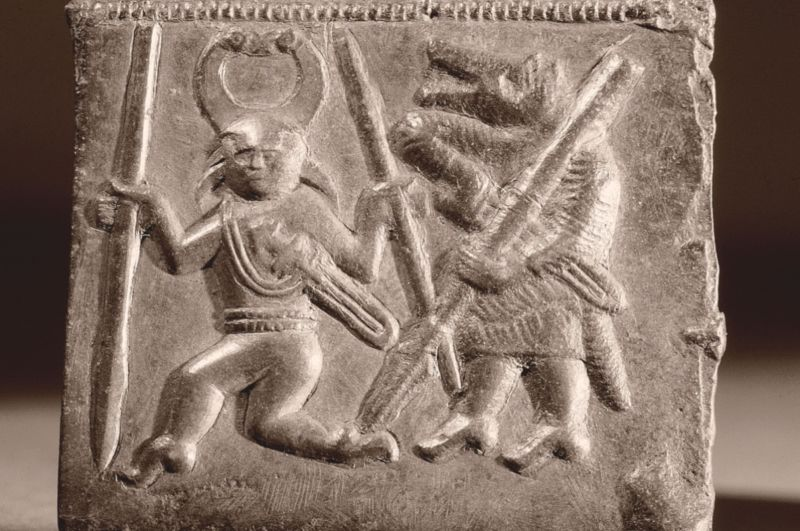 Sixth century Viking matrix used in the manufacture of helmet plaques, depicting Odin accompanied by a Berserker.