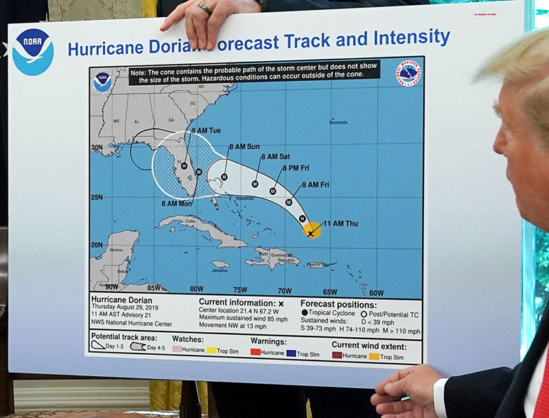 President Donald Trump displaying a doctored forecast map that incorrectly shows Hurricane Dorian hitting Alabama.