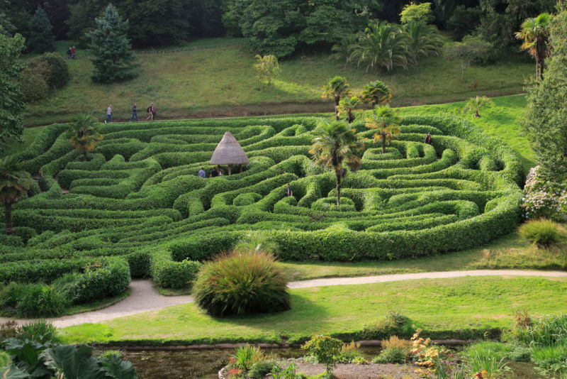 People exploring the Maze at Glendurgan Garden, Cornwall, England, UK. (Photo by: Geography Photos/Universal Images Group via Getty Images)