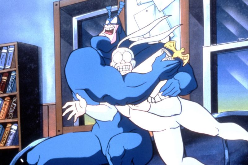 The Tick brings Mighty Blue Justice with the help of his sidekick, Arthur.
