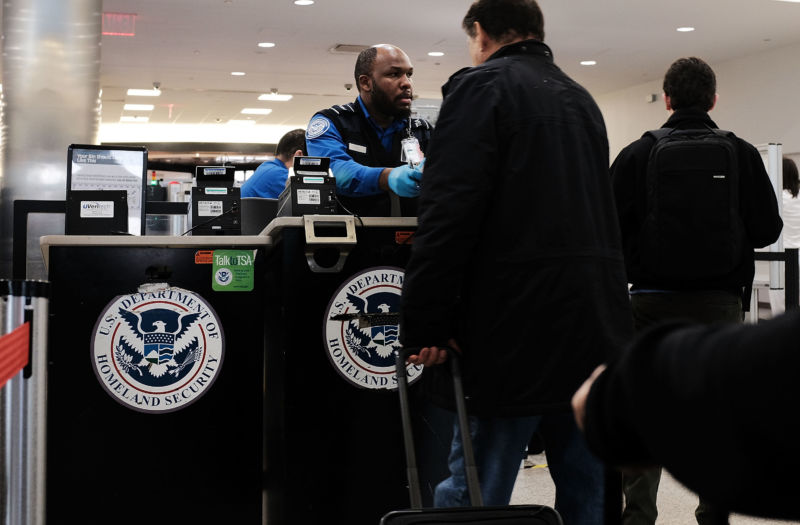NEW YORK, NY - NOVEMBER 22: A Transportation Security Administration (TSA) worker screens passengers at LaGuardia Airport (LGA) on the day before Thanksgiving, the nation's busiest travel day on November 22, 2017 in New York City.