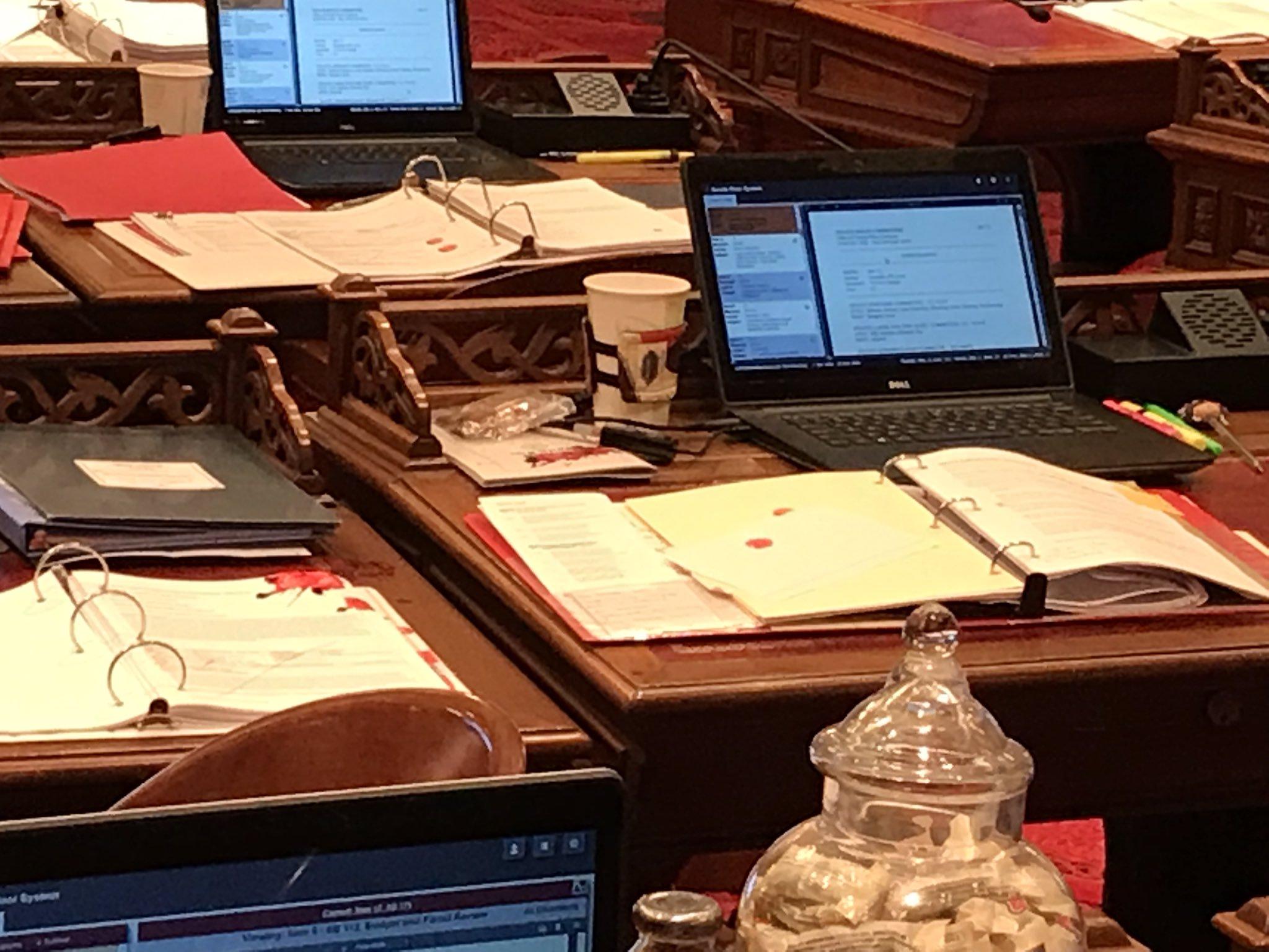 A picture of Senators' desks splattered with blood.