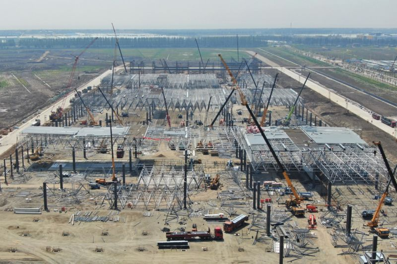 An aerial view of the construction site of Tesla's manufacturing facility is seen on April 8, 2019 in Shanghai. The factory is expected to begin production before the end of 2019, which could help Tesla meet its goal to deliver at least 360,000 vehicles for the year.