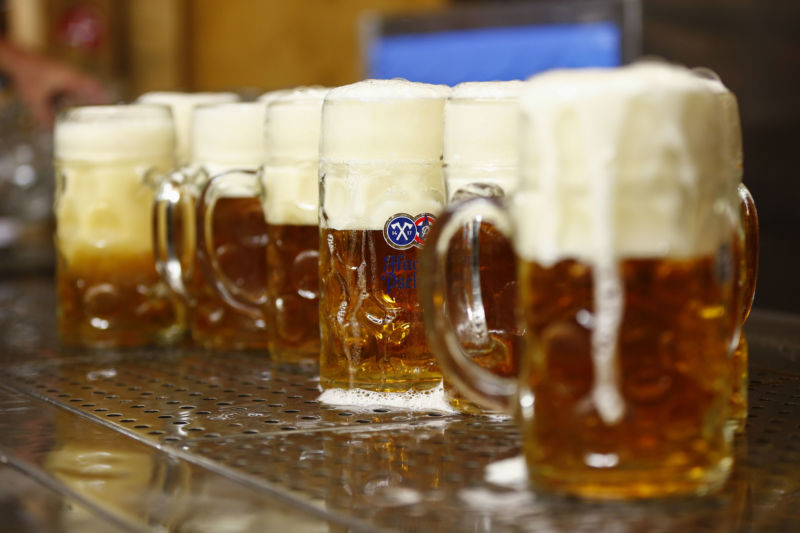 Pints of frothy beer sit on a bar at the Oktoberfest in Munich, Germany, on Thursday, Sept. 26, 2019.