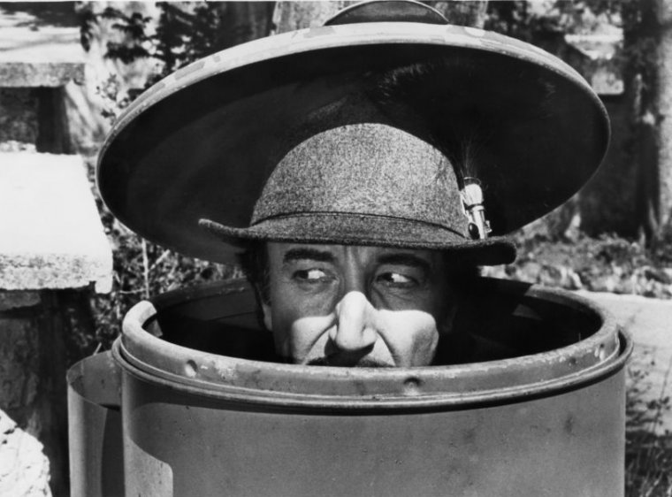Peter Sellers as Inspector Clouseau is disguised as a mountain climber, while hiding in  a trash can, in a scene from the film 'The Pink Panther Strikes Again', 1976. (Photo by United Artists/Getty Images)